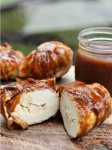 Bacon-wrapped-chicken with mason jar of BBQ sauce