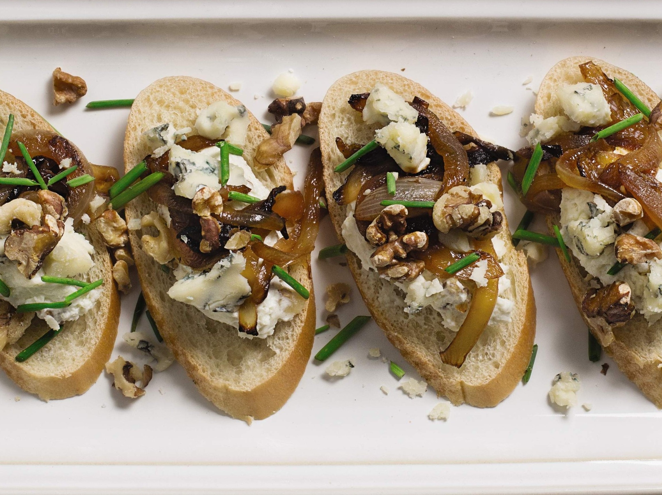 Crostini with blue cheese and walnut mousse.