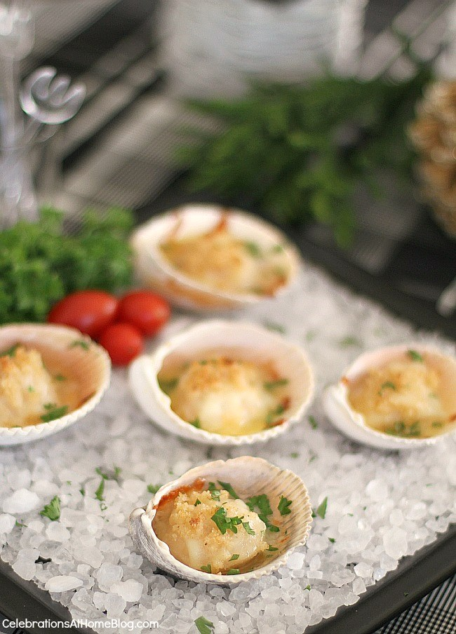 Scallops served in a shell with bread crumbs and parsley.