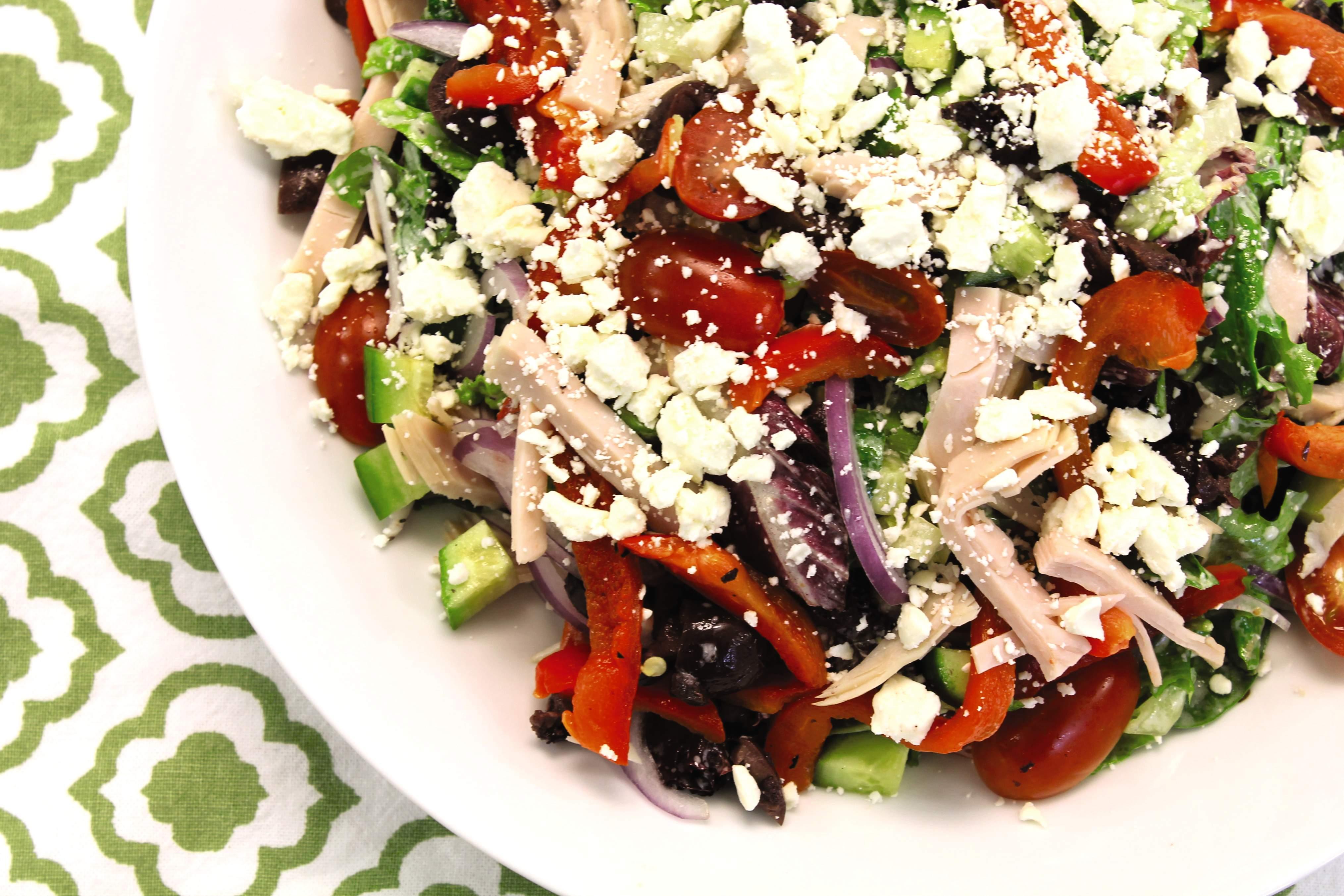 Mediterranean chopped salad with turkey, feta, and lemon yogurt dressing.