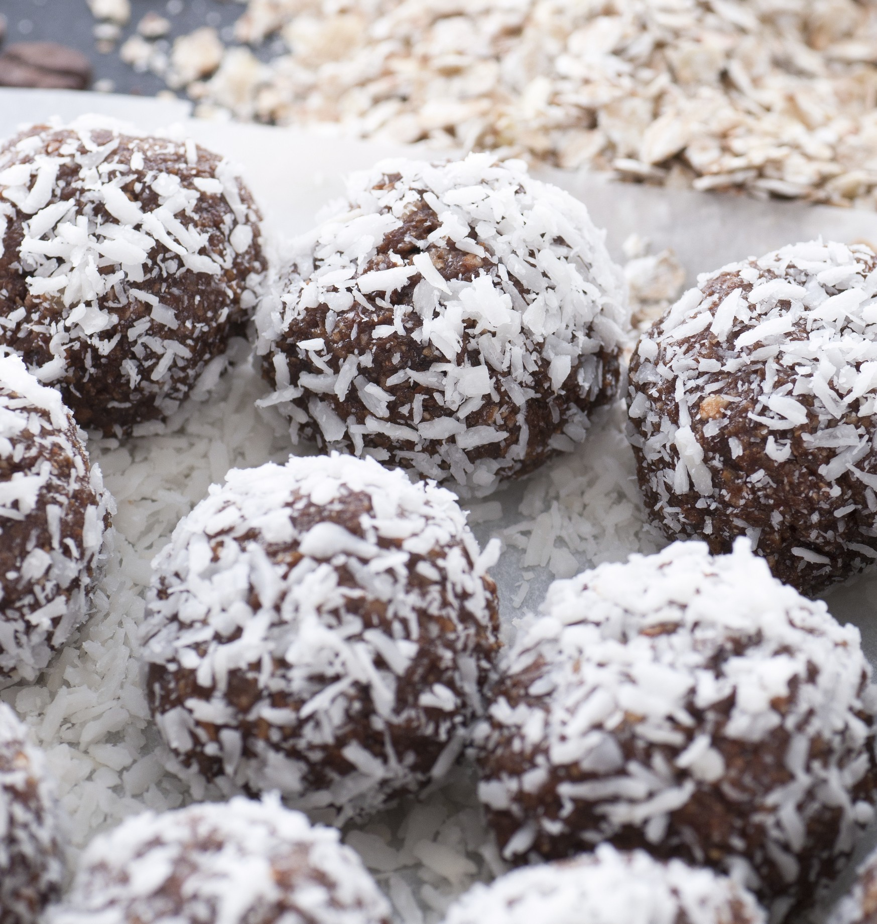 Protein balls using pumpkin puree, nut butters, and coconut flakes.
