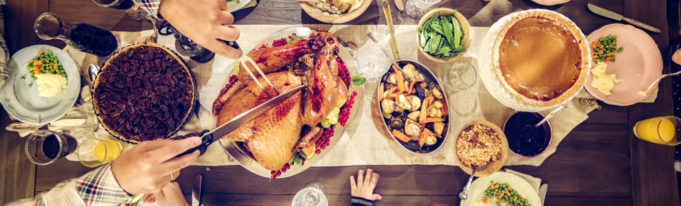 Family holiday dinner with turkey and sides.