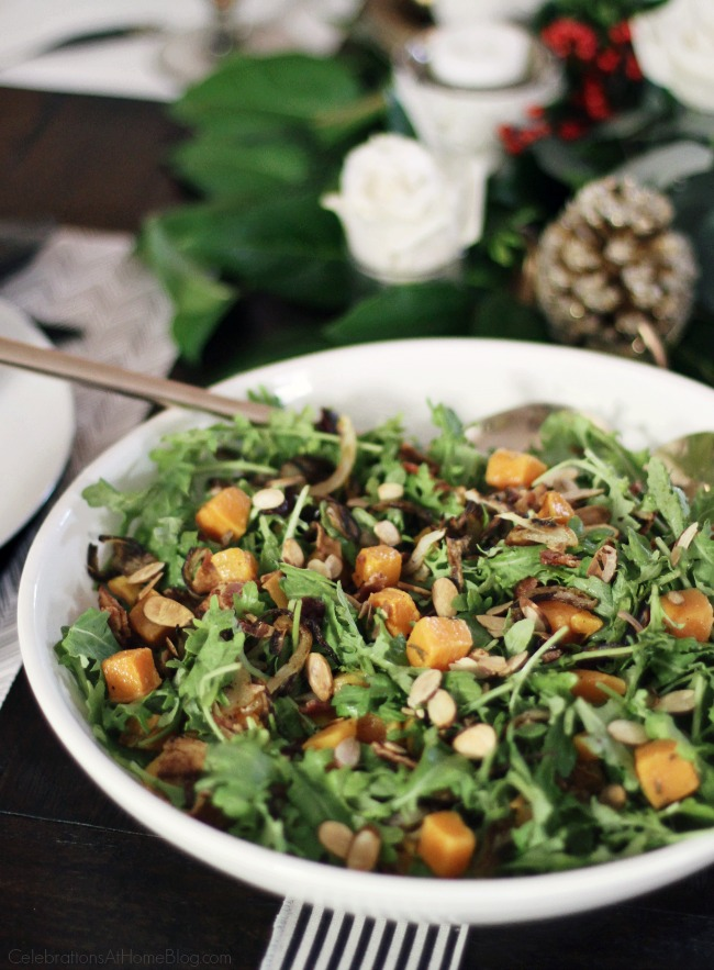 Butternut Squash Baby Kale Salad topped with cranberries, sliced almonds and bacon.