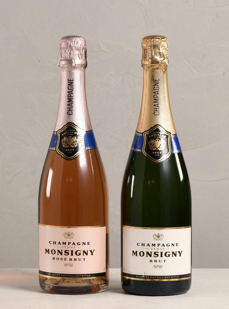 Two bottles of Veuve Monsigny Champagne varieties, Rose Brut and Brut.