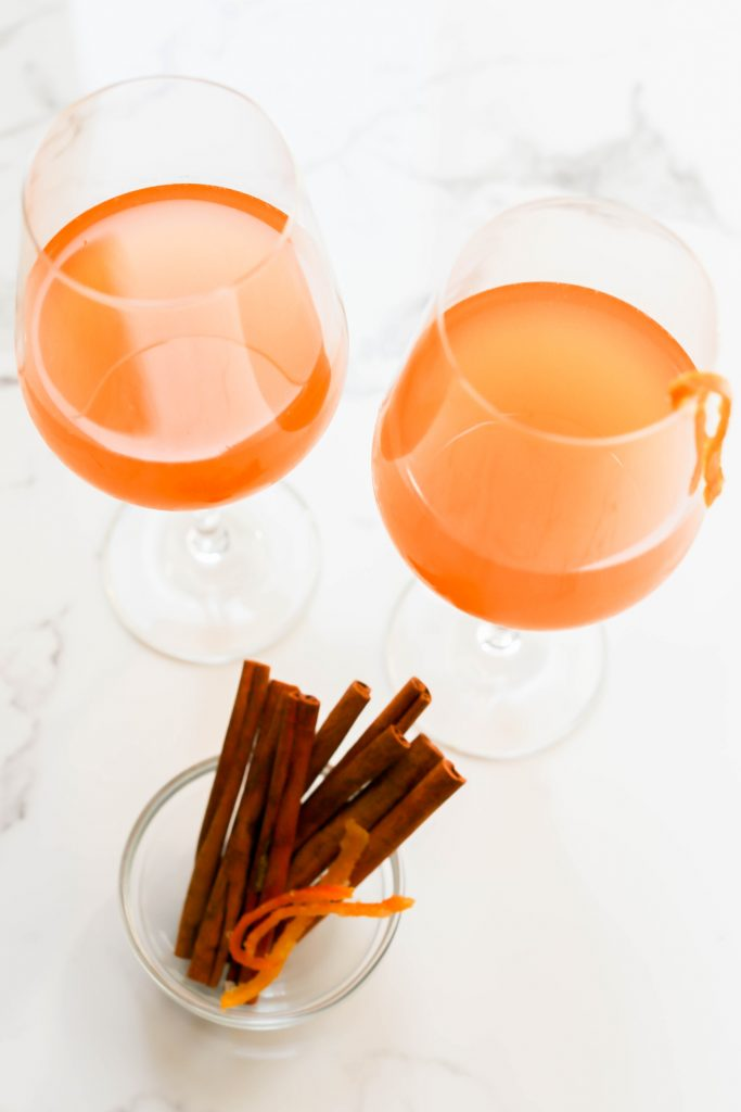 """Rosé """"Old Fashioned"""" paired with fresh cinnamon sticks and orange peel for garnish."""