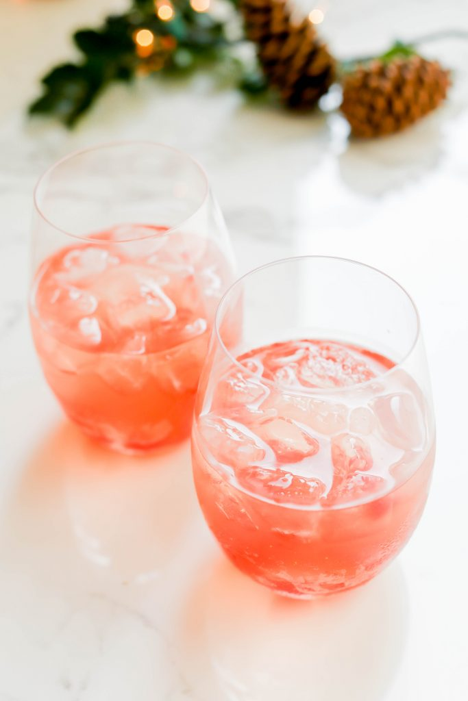 Two glasses of Rudolph's Winter Punch on a marble table.