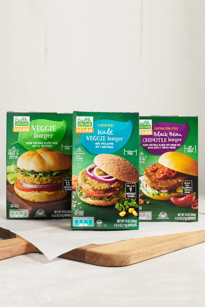 An assortment of Earth Grown Veggie Burgers including a Kale Veggie Burdger and a Black Bean Chipotle burger.