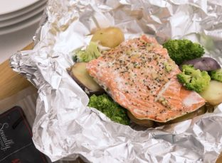 Healthy Salmon foil packet with potatoes and broccoli.