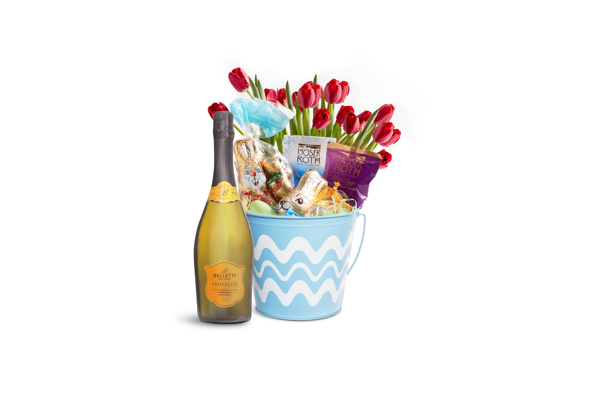 A best friend Easter basket with prosecco, chocolate and tulips.