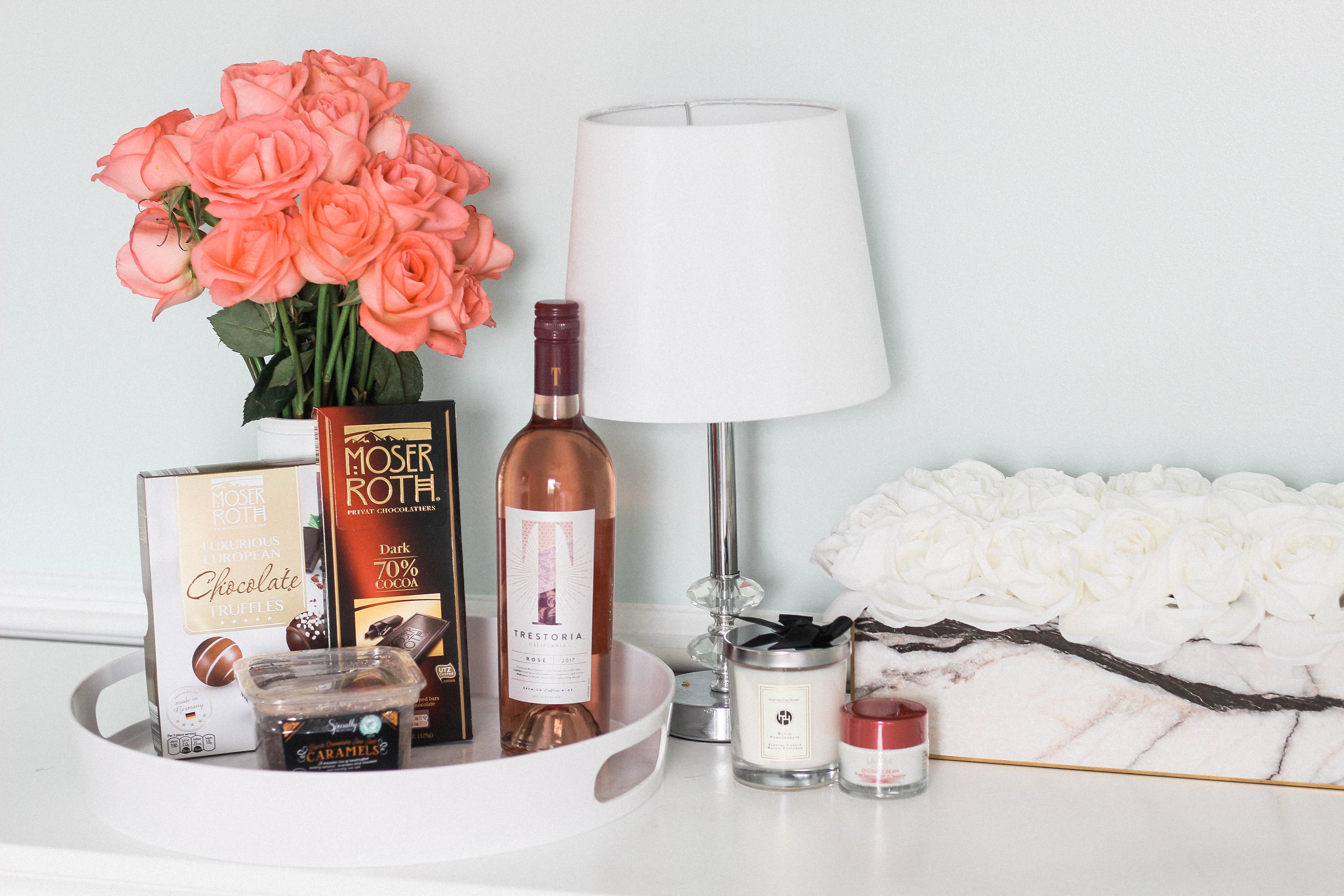 Variety of mothers day gift ideas including wine and chocolate.