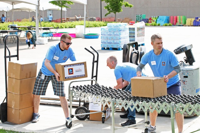 ALDI employees helping to load boxes for Feeding America.