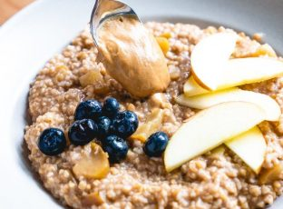 Simply Nature cashew butter poured over steel cut oats.