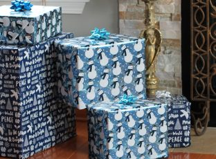 Wrapped gifts in front of a fireplace.