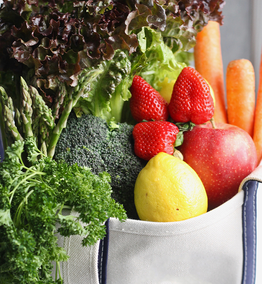 Fresh produce displayed in a canvas tote bag